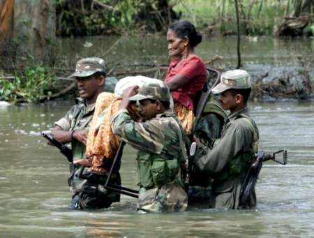 forces carrying a soldier in Sri Lanka